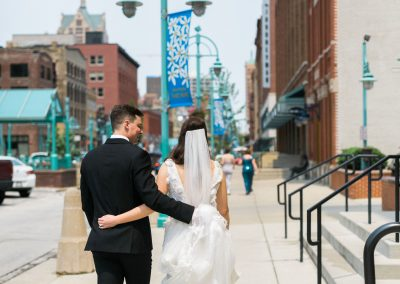 Bride and Groom Walking Milwaukee Third Ward